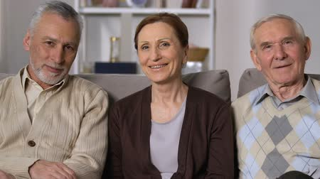 nursing : Healthy senior people smiling on camera sitting sofa, nursing home, good mood Stock Footage