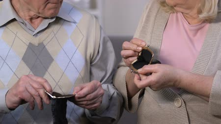 hasznosság : Desperate seniors looking in empty wallet, lack of money savings, bank deposits