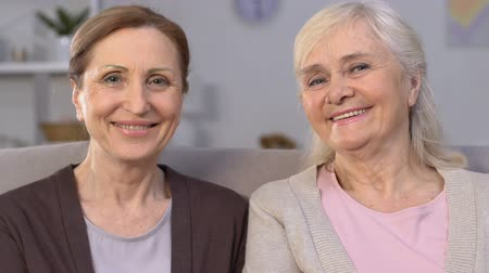protetyka : Cheerful aged women smiling at camera, dental implants, healthy teeth, care