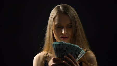 esély : Young woman stroking body with dollars, enjoying budget, casino jackpot, victory
