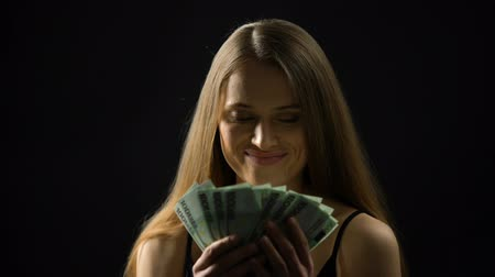 жадный : Beautiful woman stroking body with euros, enjoying income, lottery jackpot Стоковые видеозаписи