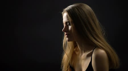 esteem : Beautiful woman isolated on black background, innocence and femininity concept Stock Footage
