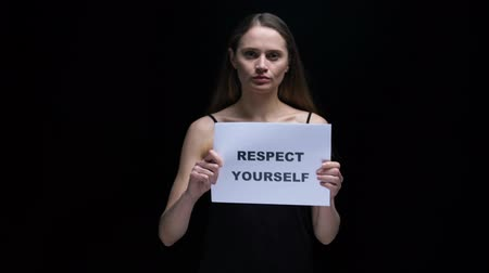 frase : Woman showing respect yourself sign, positive attitude to personality and body