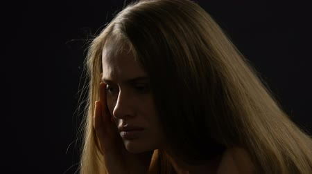 hidden face : Unhappy female feeling regret, suffering stress and depression, hiding face Stock Footage