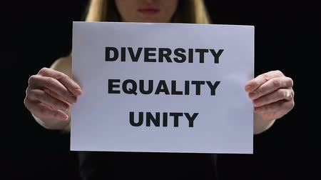 struggling : Lady holding diversity equality unity sign, struggling for female social rights Stock Footage