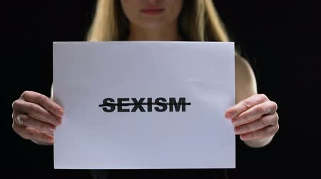 honte : Lady holding crossed sexism sign, prevent female rights oppression, inequality