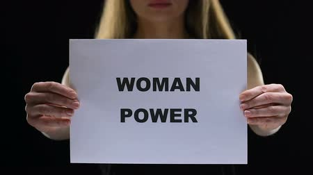 щит : Determined lady holding woman power sign, social standards change, freedom Стоковые видеозаписи