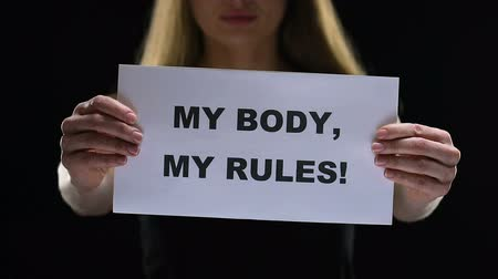 feminist : Lady with my body, my rules sign, stop different people social discrimination Stock Footage