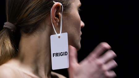 personalidade : Woman tearing frigid label from ear, protest female humiliation and offence