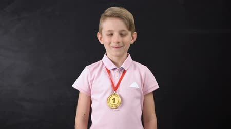 medaille : Boy with medal, prominent achievement in education, winning sport competition Stockvideo