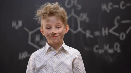 oeps : Funny dirty schoolboy feeling guilty after chemical experiment, looking to cam