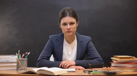 репетитор : Tired overworked female teacher looking to camera, troubles at work, burnout Стоковые видеозаписи