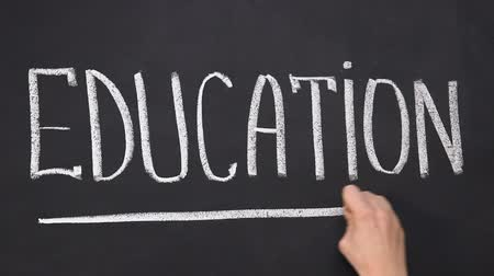 promoce : Hand underlining word education on blackboard, studying and development, school