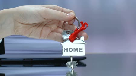 bens : Home word on keychain in woman hand, purchase or long term rental of house Stock Footage