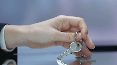 hotel suite : Vacant word on keychain, woman taking key at reception desk, free hotel room Stock Footage