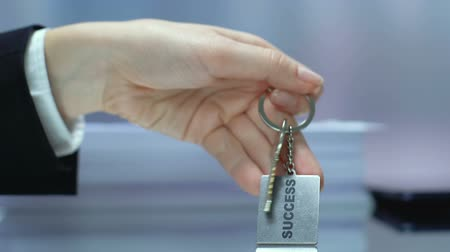 mindset : Success word on keychain, business woman taking key, motivation courses, chance Stock Footage