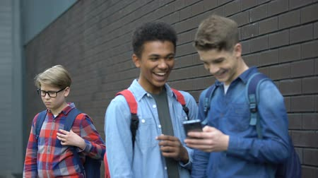 condemn : Cruel schoolmates laughing at video about bullied boy, offensive post in network Stock Footage
