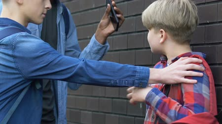 spolužák : Multiethnic teens grabbing younger boys smartphone, humiliating victim, problem