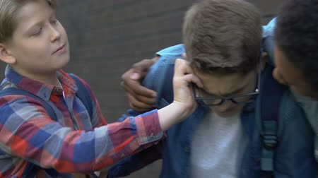 dishonor : Violent multiracial boys bullying caucasian guy, grabbing eyeglasses and phone
