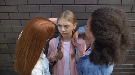 cruelty : Cruel schoolgirls pushing younger teenager against wall, psychological pressure Stock Footage