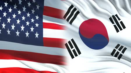 conflito : USA and South Korea officials exchanging confidential envelope, flags background