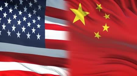 peking : USA and China officials exchanging confidential envelope, flags background Stock mozgókép