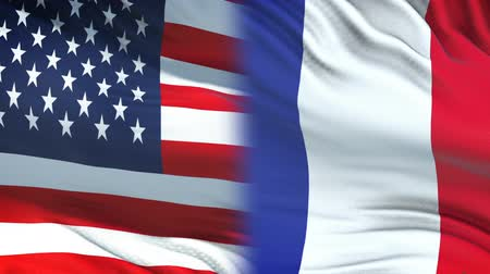 korespondence : USA and France officials exchanging confidential envelope, flags background
