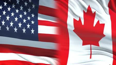archívum : USA and Canada officials exchanging confidential envelope, flags background
