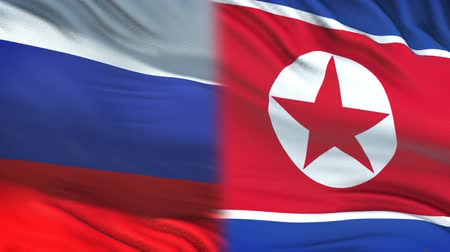 dprk : Russia and North Korea officials exchanging confidential envelope, against flags