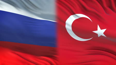 spying : Russia and Turkey officials exchanging confidential envelope, flags background