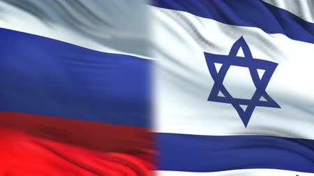 spying : Russia and Israel officials exchanging confidential envelope, flags background