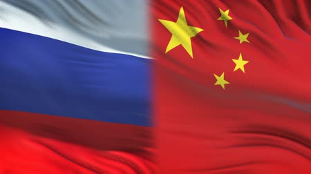 spying : Russia and China officials exchanging confidential envelope, flags background
