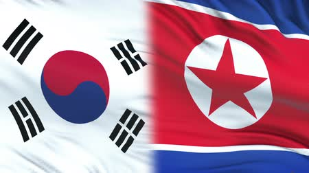 файлы : South Korea and North Korea officials exchanging confidential envelope, flags