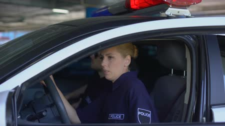 first officer : Male officer calming female teammate who crying after her first criminal scene