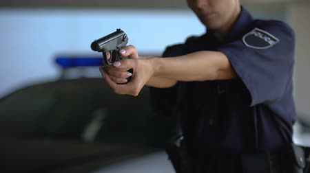 lawbreaker : Brave police woman aiming gun into dangerous criminal, important profession