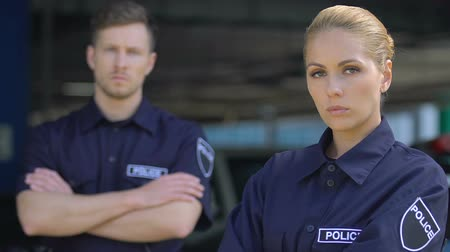 fiable : Professional male and female cops looking on camera, responsible police service