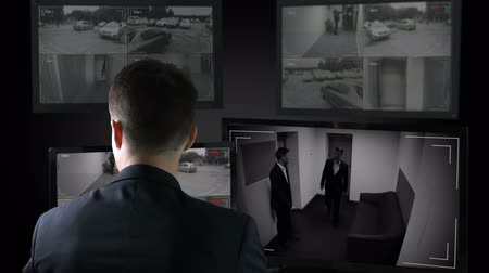 witness : Security guard looking in corporative surveillance cameras, crime scene witness Stock Footage