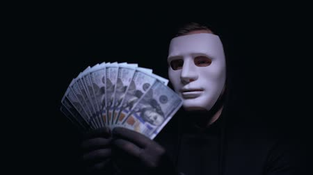 villain : Anonymous man in mask enjoying big sum of money, receiving ransom for kidnapping
