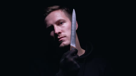 maniac : Crazy maniac holding knife near his throat, preparing for cruel murder, closeup Stock Footage