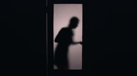 cruelty : Silhouette of scared woman knocking at glass door checking handle, fear, escape