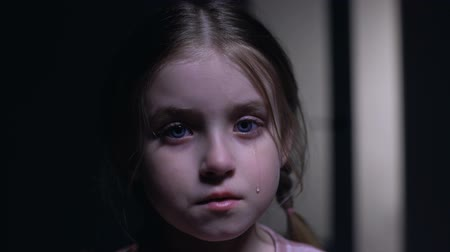 maltreatment : Little crying girl looking at camera, victim of domestic violence, childs rights