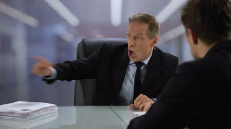 sedative : Furious boss shouting at male employee, clenching resume and throwing away Stock Footage