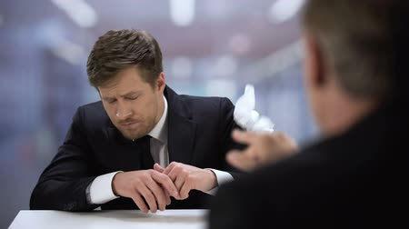 subordinate : Boss throwing presented business plan to young entrepreneur, dismissal from job Stock Footage
