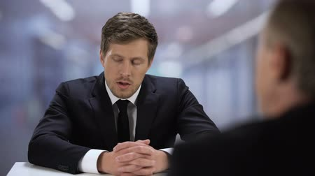 curriculum vitae : Company HR manager watching through young man resume, job interview failure