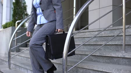 dismissal : Dismissed senior lady leaving office building, old age opportunities, positivity Stock Footage