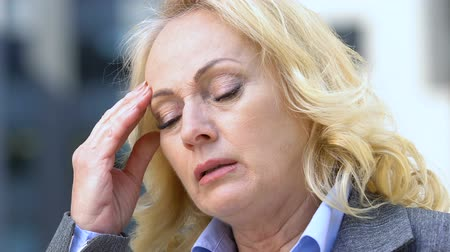 nervous breakdown : Exhausted woman suffering headache, worrying about life troubles, dismissal Stock Footage