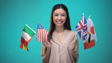 visa : Woman holding many flags, choosing country to travel, international relations