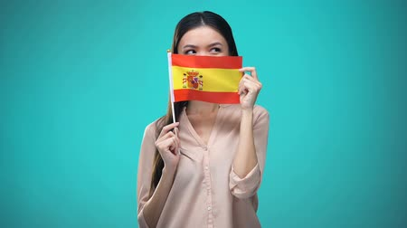 financiamento : Girl covering face with Spanish flag, learning language, education and travel