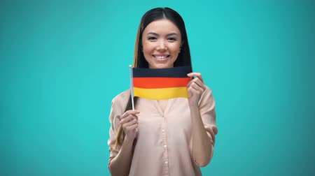 zahraniční : Lady covering face with German flag, learning language, education and travel Dostupné videozáznamy