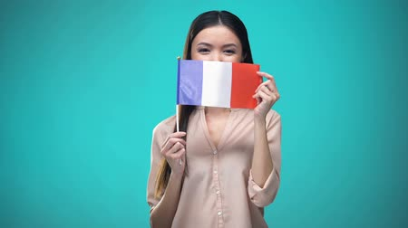 finansman : Girl covering face with French flag, learning language, education and travel Stok Video